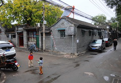 """China Beijing hutong backalley street-view with kid having a pee - """"Whizz Kids"""" (moreska) Tags: china travel roof pee rain architecture kids asia cityscape afternoon backalley cloudy candid beijing kingdom streetscene structure motorbike alleyway housing hutong middle hazy puddles narrow neighborhoods streetview unstaged hepingman"""
