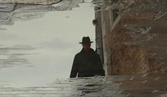 Then came a mysterious man.. (Croix-roussien) Tags: reflet reflection homme portrait flaque chapeau hat noir strange jeanmoulin pavé cobblestone rue street urban city upsidedown lyon