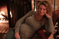 "baby sister + baby niece (listening to ""walking after you"", foo fighters) (jeneksmith) Tags: christmas family winter light portrait woman baby cold love beauty canon fire warm december peace bokeh sister mother pregnant 50mmf18 canoneos70d"