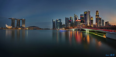 MBS + CBD in the evening (Ken Goh thanks for 2 Million views) Tags: longexposure blue sunset sky cloud reflection water skyline marina evening bay sand singapore pentax smooth sigma nopeople panoramic cbd 1020 mbs centralbusinessdistrict ndfilter k5iis