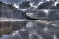 Light curtains (pauldunn52) Tags: light sun seascape heritage beach wet wales clouds stairs temple bay coast sand cliffs glamorgan limestone layers rays shafts whitmore