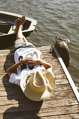 young man sleeping on the pier, vacation (pruden2009) Tags: boy sleeping summer vacation people sun man feet water field hat modern river season outdoors happy evening pier pond nap quiet young relaxing lifestyle happiness places sleepy exotic hammock heat rest casual resting conceptual lying idyllic sunbathing pleasure summervacation destinations summerinthecity sleepingman citybreak vacationspot