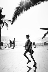 Vamos a la Playa (Georgie Pauwels) Tags: street light sun beach palms streetphotography playa beachlife run fujifilm moment lapalma