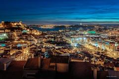 Lisbon at night (adrianchandler.com) Tags: city bridge blue houses urban castle portugal water skyline architecture night buildings dark europe mediterranean waterfront view rooftops outdoor lisboa lisbon shore hour bluehour pt sprawl
