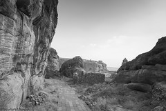 Getting closer to top of the cliffs (magicallights) Tags: travel sculpture india history landscape ancienthistory ancient hiking canyon cliffs caves karnataka badami incredibleindia indianhistory badamicaves