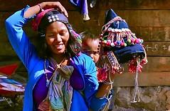 Laos-Akha village (venturidonatella) Tags: portrait people colors smile hat women asia village mother persone donne laos colori ritratto gentes akha minorities minoranza akhatribe traditionalhat