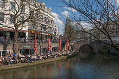 Unseasonably warm weather brings crowds to the Oudegracht (natures-pencil) Tags: city bridge netherlands canal utrecht domtoren nederland restaurants wharf shops crowds diners cafes oudegracht canalside wharves cathedraltowerbridgehistoricspringsunshineblueskywideanglecity centrelovely