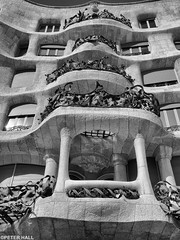 Facade (peterphotographic) Tags: barcelona city urban blackandwhite bw building window monochrome architecture facade spain europe cityscape apartment flat terrace balcony olympus catalonia espana gaudi modernarchitecture modernisme lapedrera antonigaudi microfourthirds silverefexpro2 peterhall em5mk2 p3110296edsefexwm