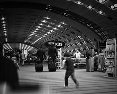 Departures (Mister Blur) Tags: light boy blackandwhite 35mm airport nikon gate diary run departures chronicles charlesdegaulle boarding roissy cdg traveler takethelongwayhome endofthejourney d7100 wetravel thelighttraveler