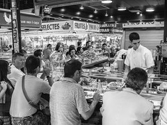 Lunchtime At La Boqueria (J Wells S) Tags: barcelona urban blackandwhite bw fruits monochrome vegetables restaurant spain streetscene catalonia laboqueria publicmarket urbanstreetscene lesrambles themercatdesantjosepdelaboqueria theciutatvelladistrict