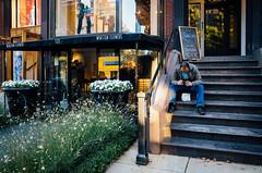Newbury Street (Nora Kaszuba) Tags: man stairs cellphone newburystreet bostonmassachusetts norakaszuba