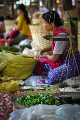 Inle Lake Market - Woman Selling Vegetables (Nicholas Olesen Photography) Tags: travel people woman lake tourism vegetables nikon asia market burma onions scales baskets myanmar inle southeast selling d90