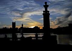 Clouds (mykadog) Tags: sunset sky lake clouds buildings streetshot supershot