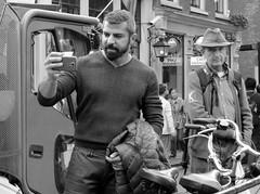 amsterdam zeedijk (gerben more) Tags: street people man monochrome bike beard blackwhite cellphone streetlife streetscene handsomeman