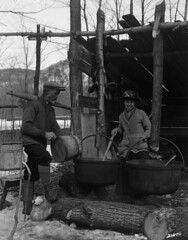 Boiling maple sap in the sugar bush / bullition de leau drable dans une rablire (BiblioArchives / LibraryArchives) Tags: woman canada man maple quebec femme lac qubec syrup maplesyrup sap rable homme bac boil 1926 sugarshack cabanesucre sirop sve sainthilaire libraryandarchivescanada canadiannationalrailways siropdrable bibliothqueetarchivescanada bouillir cheminsdefernationauxducanada