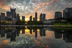BOOM (Landscape Junkie) Tags: sunrise reflections cityscape malaysia kualalumpur sigma1020mm leefilters nikond90 lee09s landscapejunkie klccsymphonylake muhamadfaisalibrahim