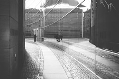 Curved (freyavev) Tags: street urban blackandwhite bw glass lines architecture germany way bayern deutschland bavaria shadows outdoor path nuremberg grain streetphotography museumofmodernart nrnberg neuesmuseum refelections
