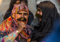 bandari women wearing the traditional masks called the burqas with a moustache shape, Qeshm Island, Salakh, Iran (Eric Lafforgue) Tags: people face horizontal outdoors photography persian clothing women asia veil mask iran muslim islam traditional religion hijab culture persia tribal womenonly clothes hidden masks covered iranian tribe 2people twopeople adultsonly cultural islamic traditionaldress burqa customs middleeastern persiangulf sunni qeshmisland burka chador hormozgan burqua  waistup  middleagedwomen  iro straitofhormuz  colourpicture  salakh borqe boregheh iran034i9599