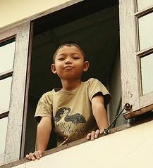 boy in a window (the foreign photographer - ) Tags: boy window portraits canon thailand kiss bangkok khlong bangkhen thanon 400d