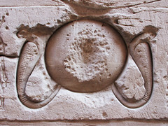Cobras and Sun Egyptian Carving (shaire productions) Tags: old sun history stone wall temple photo carved sandstone tour image artistic egypt picture culture carving photograph horus gods snakes archeology mythology risingsun cultural archaic edfu cobras templeofhorus egyptandthenile