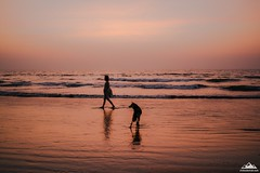 Walking at sunset (Oleh Slobodeniuk) Tags: ocean travel sunset sea dog color film girl 35mm mood goa tranquility wave oceans travelers arambol