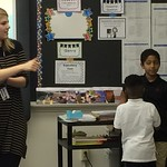 A student teaching elementary students in a classroom