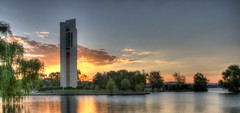 Carillon_Canberra_IMG_2190_1_2_3_4_5_Painterly (2) (Roy Wales) Tags: pink sunset panorama orange lake water yellow clouds canon landscape landscapes purple pano lakes sunsets australia belltower cropped canberra ef act carillon waterscape ef1740f4l circularpolariser photomatix canonlglass australiaallover beautyofwater canoneos7d