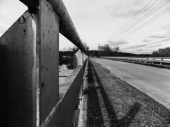 In line (Teresa Kiddy) Tags: road bridge lines concrete symmetry wires walkway poles asphalt