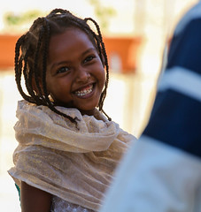 The excitement of the female-male encounter (ybiberman) Tags: portrait playing girl laughing easter israel veil candid jerusalem streetphotography chic ethiopianchurch