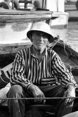 Istanbul Boatman (Peter at PicPlan) Tags: 1969 hat fishing istanbul boatman