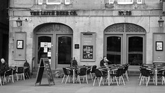 Leith Beer Company 01 (byronv2) Tags: street blackandwhite bw monochrome sign bar table scotland blackwhite pub chair edinburgh chairs candid tables leith edimbourg theshore leithbeercompany