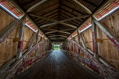 Passageway to another time (Alan Amati) Tags: bridge alan boards cross time availablelight interior machine indiana tunnel structure covered coveredbridge another planks beams timbers passageway medora in bygone amati