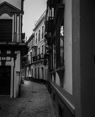 Streets of Seville (vuralyavas) Tags: street light blackandwhite bw white black building monochrome lines architecture blackwhite sevilla spain streetphotography seville architectural espana bnw artphotography