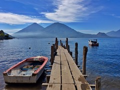 Volcanoes at Lake Atitln ((Jessica)) Tags: travel lake water boats lago volcano boat dock guatemala atitln canoe atitlan canoes volcanoes cayucos sanpedro pw iphone volcn tolimn cayuco sanantoniopalop iphone6s