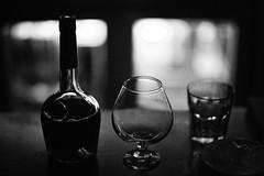 Khaali Jaam Liye baithe ho (N A Y E E M) Tags: light monochrome night hotel bottle availablelight grain xo brandy cognac bangladesh goblet chittagong courvoisier radissonblu baikalbar