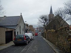 Church Road, Stromness (Dunnock_D) Tags: road street uk trees houses sky cloud wall grey scotland orkney cloudy unitedkingdom harbour stromness