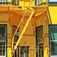 'inclined' to get away (msdonnalee) Tags: window yellow architecture facade jaune ventana shadows fenster ombra victorian sombra ombre finestra amarillo amarelo gelb giallo fireescape janela fachada schatten apartmentbuilding faade notausgang  baywindow   shadowsonthewall  salidadeincendios facciate sanfranciscoarchitecture escalierdesecours victorianapartment scaladisicurezza diagonalshadows sadadeincndio