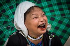 Vietnam: femme Dzao sous son parapluie (claude gourlay) Tags: portrait people face asia retrato vietnam asie ethnic dao minority ritratti ritratto dzao indochine tonkin ethnie minorit btel claudegourlay