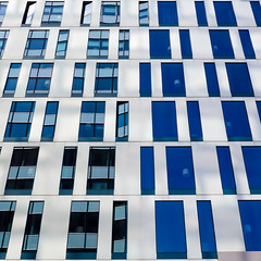 Reflective dichotomy (uneitzel) Tags: blue reflection building window architecture square fenster hamburg architektur blau spiegelung gebude dichotomy mzuiko17mm olympusem5