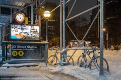 Snowy Bicycles - 1/23/16 (P1233858) (Michael.Lee.Pics.NYC) Tags: winter snow newyork clock scaffolding olympus bicycles subwaystation fifthavenue mkii markii 2016 flatirondistrict em5 voigtlandernokton175mm ridealong2