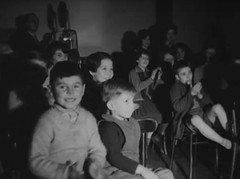 Film show in a children's home (theirhistory) Tags: christmas xmas uk girls film boys kids children scotland projector orphanage orphans event jumper shorts dungarees 16mm childrenshome