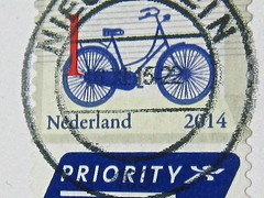 a stamp = a country's tag on the mail (muffett68 ☺ heidi ☺) Tags: blue macro netherlands bicycle tag nederland stamp macromonday