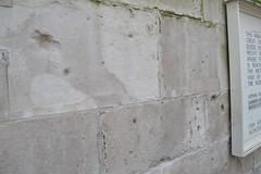 Shrapnel marks on the Monument (Matt From London) Tags: london monument wwii shrapnel