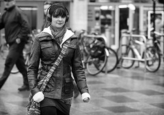 Stripes and Eyes.jpg (Just Ard) Tags: street people blackandwhite bw woman white black blancoynegro girl monochrome face scarf bag person photography mono nikon eyecontact noiretblanc zwartwit candid stripes 85mm d750 headphones unposed  biancoenero schwarzundweis justard