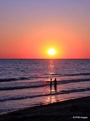 Lido Beach Sunset (pandt) Tags: ocean sunset sea sky sun beach gulfofmexico water canon children landscape eos coast seaside sand flickr waves florida outdoor shore sarasota waterscape lidobeach t1i