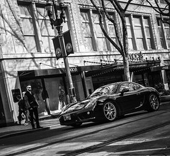 Stopping For Cars (TMimages PDX) Tags: road street city people urban blackandwhite monochrome buildings portland geotagged photography photo image streetphotography streetscene sidewalk photograph pedestrians pacificnorthwest avenue vignette fineartphotography iphoneography