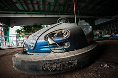 I know everything you don't want me to (Erin Watson/Abandoned Exploration) Tags: park new old travel family blue light urban usa history abandoned broken car wheel electric glitter america canon tickets katrina amusement photo orleans midwest closed quiet photographer ride steering angle decay empty seat united explorer hurricane low wide ruin flags rubber dirty historic sparkle adventure falling explore dirt entertainment bumper photograph forgotten porn memory theme headlight states nola steer grime busted six exploration decayed seatbelt ue erinwatson erinwatsonphotography