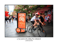 Cyclists advertising signs for Chinese New Year celebrations (sugarbellaleah) Tags: people hat bicycle sign festival fun happy chinatown cyclist ride events sydney australia chinesenewyear celebrations shops haymarket conical advertise dixonstreet