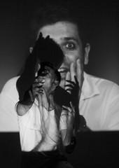 Admiration (Louise de Cours) Tags: light shadow portrait people blackandwhite man france art 35mm canon photography dance movement emotion expression experiment lifestyle dancer aixenprovence explore projection interpretation superposition videoprojection personalproject