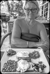 Beakfast, not really hungry. (CWhatPhotos) Tags: pictures camera morning portrait people food woman white black monochrome breakfast digital turkey that mushrooms photography mono bacon cafe beans foto image artistic pics toast tomatoes egg picture pic olympus images have eat photographs photograph fotos which turkish contain marmaris onthe em10 cwhatphotos